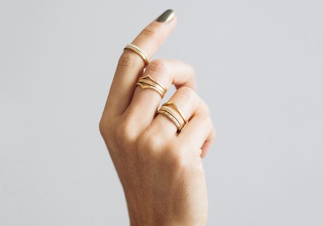 Hand wearing rings