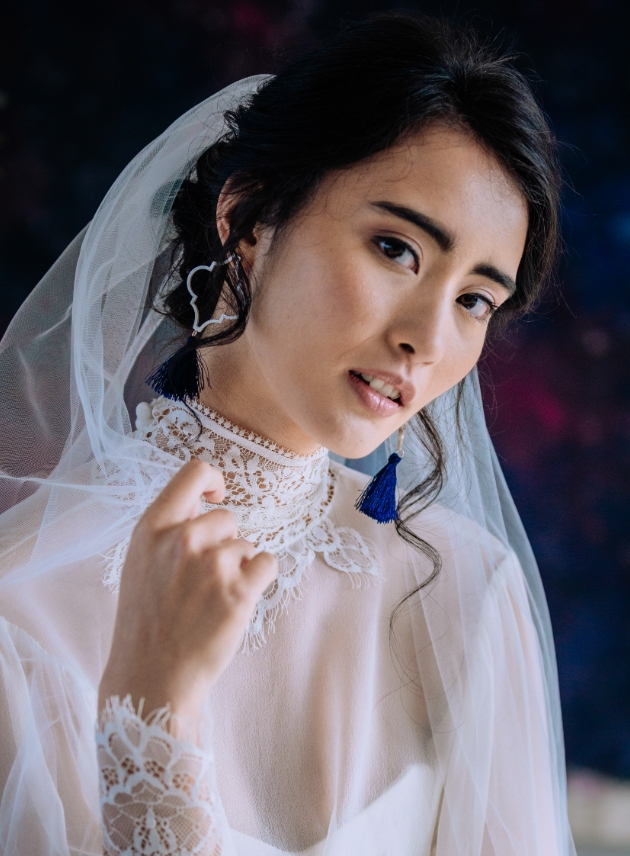 Bride with dress on and veil