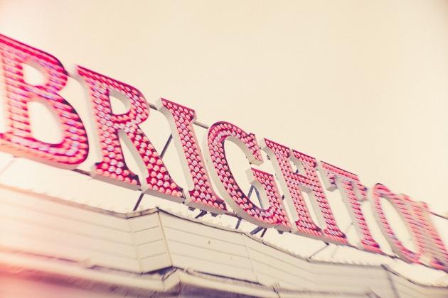 the word Brighton in red fairground lights