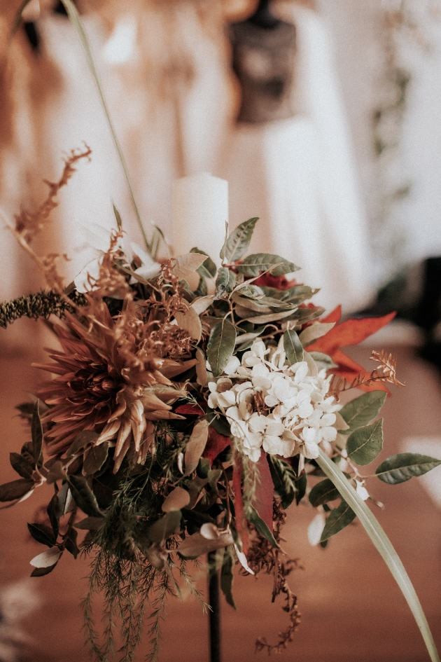 Autumnal flower arrangement including dried flowers