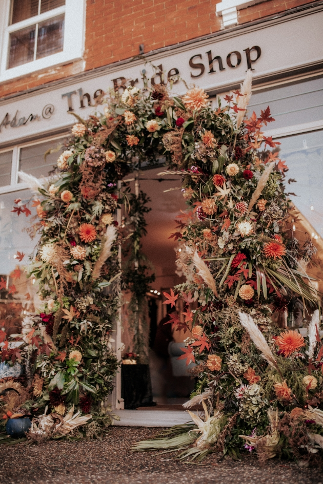 Flower arch over the entrance of The Bride Shop