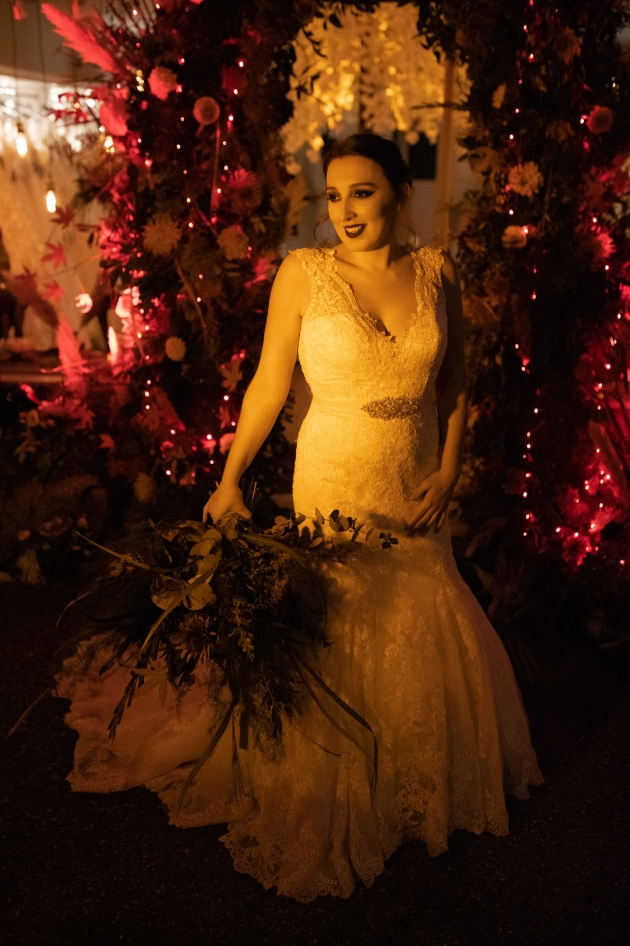 Bride in spooky setting with black lipstick