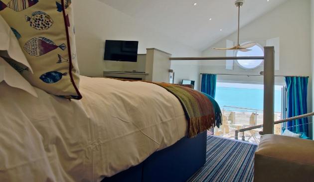 Beach hut bedroom mezzanine with view