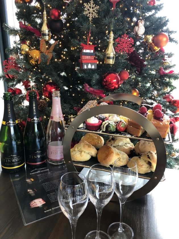 Tinwood's sparkling afternoon tea in front of christmas tree