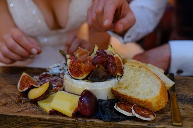 bride and groom tuck into their wedding breakfast grazing platter