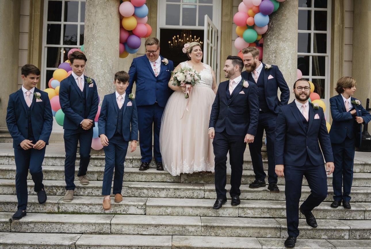 Newlyweds and groomsmen