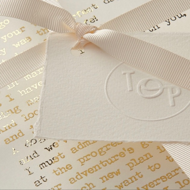Poem in gold foil font and tied with a ribbon from the Original Poet