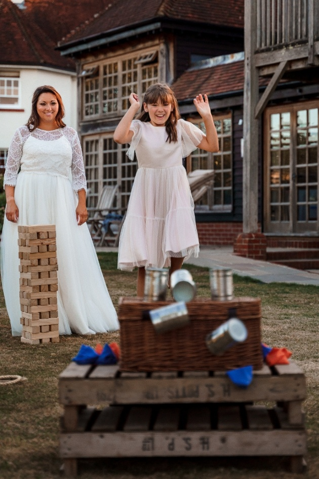 bride and flowergirl playing lawn games