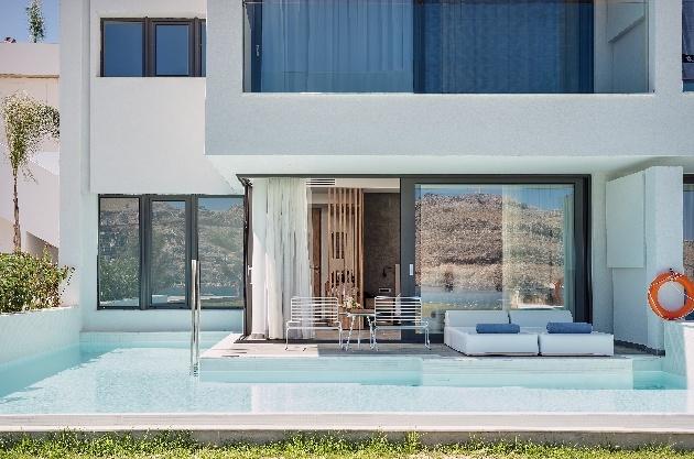 junior suite white exterior with pool
