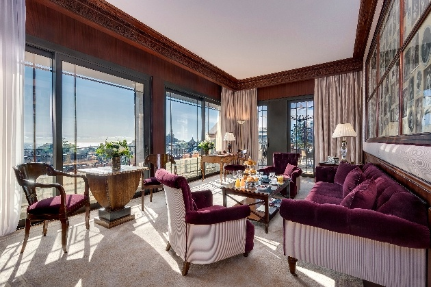 hotel room with city views and burgundy decor