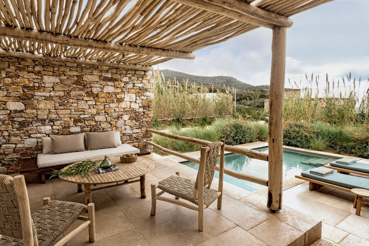 garden view suite with seating outside by little pool surrounded by foliage