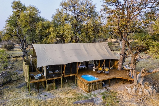 lodge camp with pool in trees