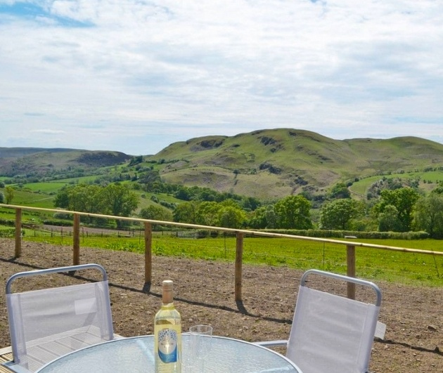 table and chair with view of hills