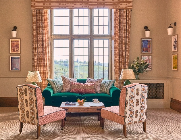 sofa and chair in front of large window