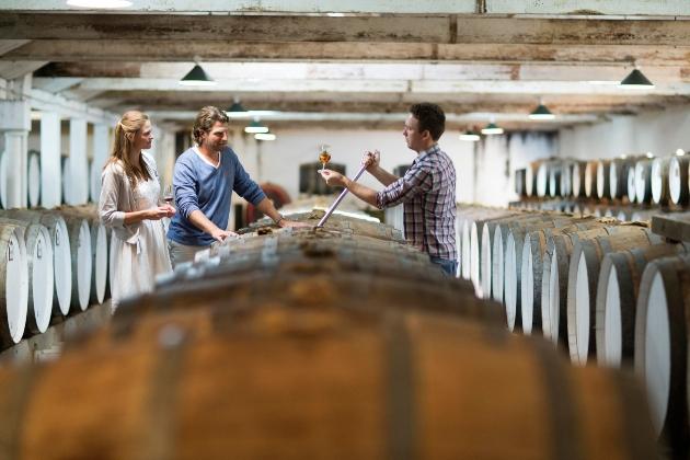 couple in cellar of barrels