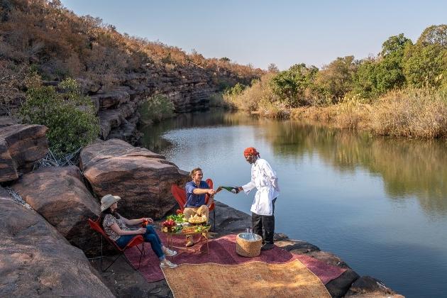 safari dinner by river waiter