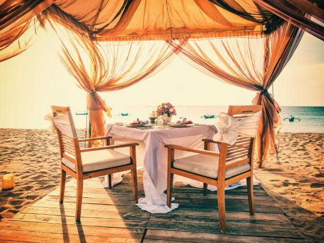 dinner table and chairs on beach