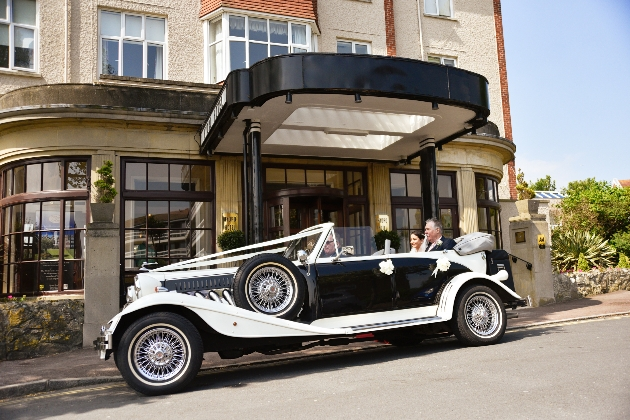 Vintage white and black wedding car outside the Hydro Hotel EAstbourne