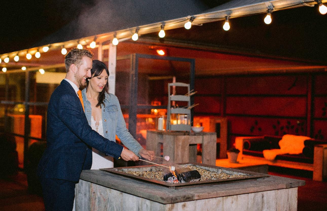 Newlyweds toasting marshmallows